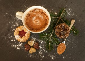 A top down view of a cup with cookies, spoon, and pinecone nearby for Equipoise Teletherapy. Contact us to learn about binge eating disorder treatment in Chicago, IL, online binge eating disorder treatment, and other services.
