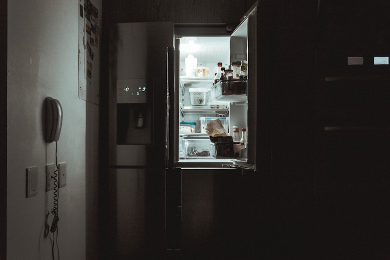 An open fridge is shown. This represents concepts of emotional eating in Chicago, Il. Our online therapists in Illinois are able to provide online therapy for emotional eating.