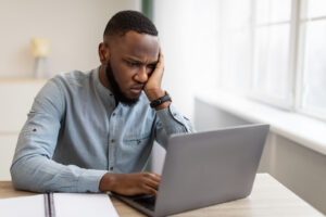 A man appears frustrated. This relates to concepts of online therapy in Illinois. An online therapist in Illinois is able to assist with depression counseling and anxiety treatment.