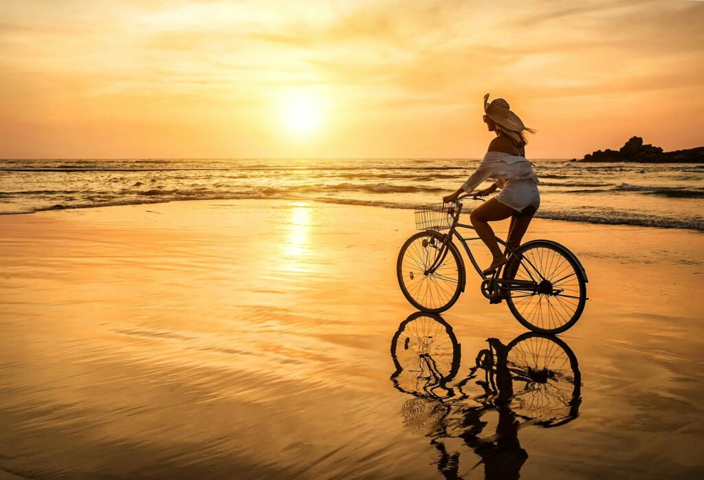 A photo shows a woman on her bike. She is feeling much better since starting online PTSD treatment in Chicago, IL with Equipoise Teletherapy.